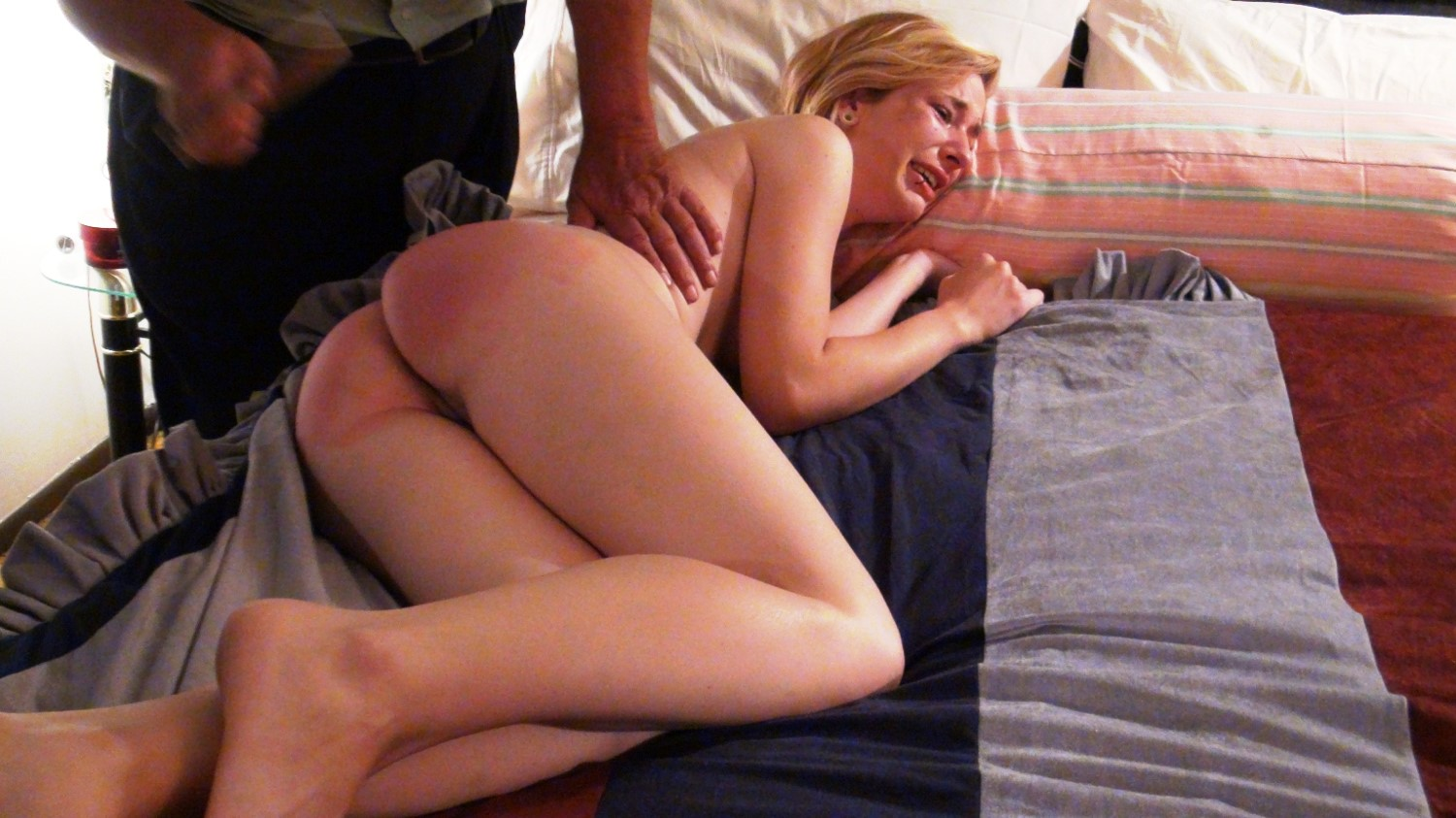 Spanked over her bed